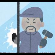 強盗が窓を割る